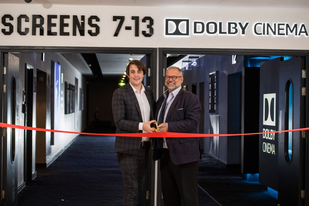 Julian Stanford, Senior Director, Dolby Cinema Europe (right), and Dan Formby, GM, ODEON Manchester Trafford Centre (left) cut the ribbon for the brand-new Dolby Cinema at ODEON Trafford Centre. Photo Jon Park